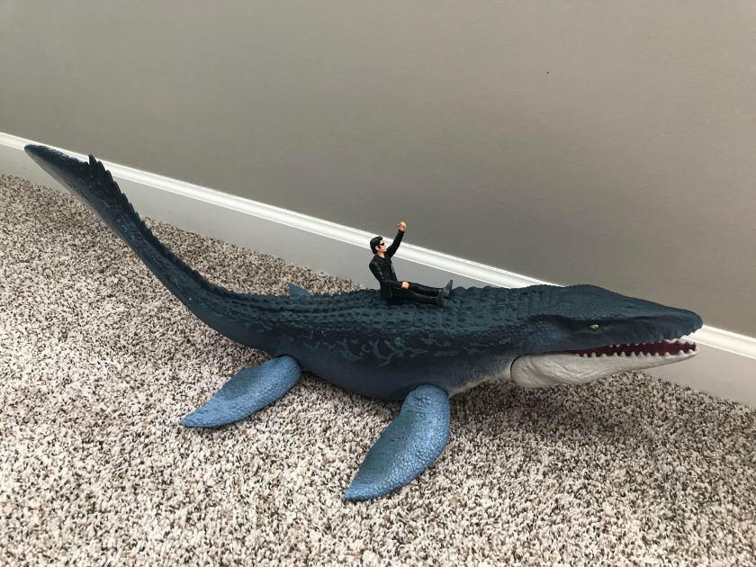 ian riding a mosasaurus